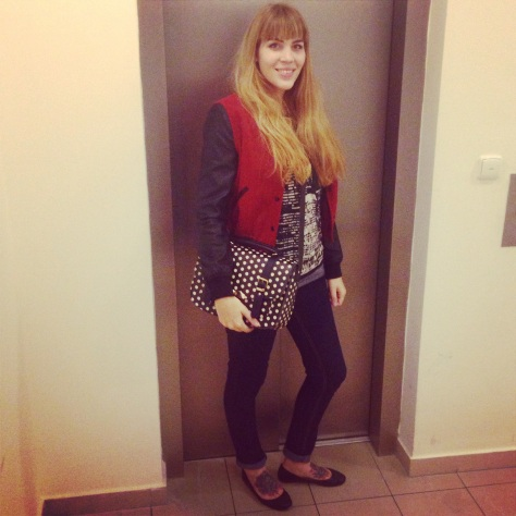 blogger outfit: skinny jeans, baseball jacket, polkadot bag and studded shoes